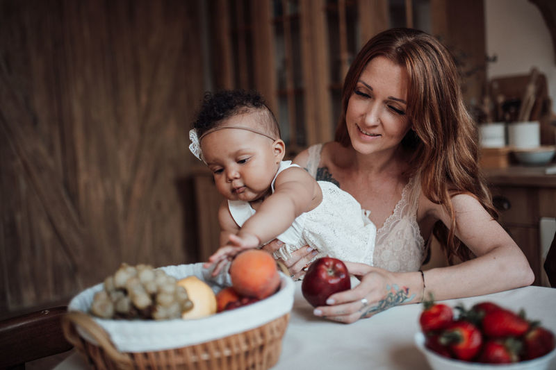 Mother and daughter with fruits