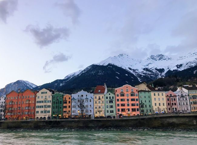 Colorful Building Town Panoramic Street Embankment Twillight Colorful Houses Travel Destinations Tyrol Austria River Mountain Building Exterior Architecture Built Structure House Sky Cold Temperature Snow Waterfront Water Outdoors Winter Nature Mountain Range Residential Building Beauty In Nature City Scenics