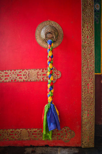 Close-up of decoration hanging against wall