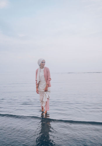 // whatever you're, be a good one // Japan Muslim Religious  Scarf Model EyeEm EyeEm Selects Portrait Portrait Of A Woman Past Pastel Pastel Colored Tones AMPt_community Shootermag Water Sea Waterfront Leisure Activity Sky Lifestyles Standing Beauty In Nature Real People Full Length Nature Two People Day Adult Women Togetherness Scenics - Nature People Outdoors Positive Emotion Horizon Over Water Couple - Relationship Smile Smiling