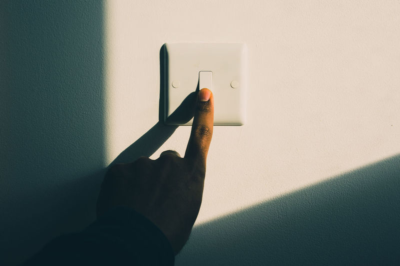 Electric Switch Lights Contrasting Electricity  Energy Hand Human Body Part Indoors  Saving Energy Shadow Turning Off Light Turning On The Light