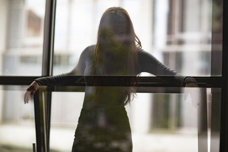 Beautiful young woman silhouette in front of glass window Portrait Of A Woman Silhouette Standing Beautiful Woman Beauty Caucasian Ethnicity Day Daylight Female Front View Girl Glass - Material Leaning Modeling One Person Posing Real People Reflections Standing Transparent Waist Up Window Windows Women Young Adult