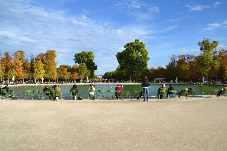 Group of people at park against sky