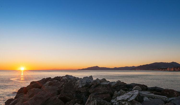 Sunset in the Eastern Liguria Beauty In Nature Cape  Cavi Di Lavagna Clear Sky Gulf Idyllic Landscape Nature No People Outdoors Portofino Ray Rays Of Light Rocks Scenics Sea Sun Sunset Tigullio Tranquil Scene Tranquility Travel Destinations Vacations Water