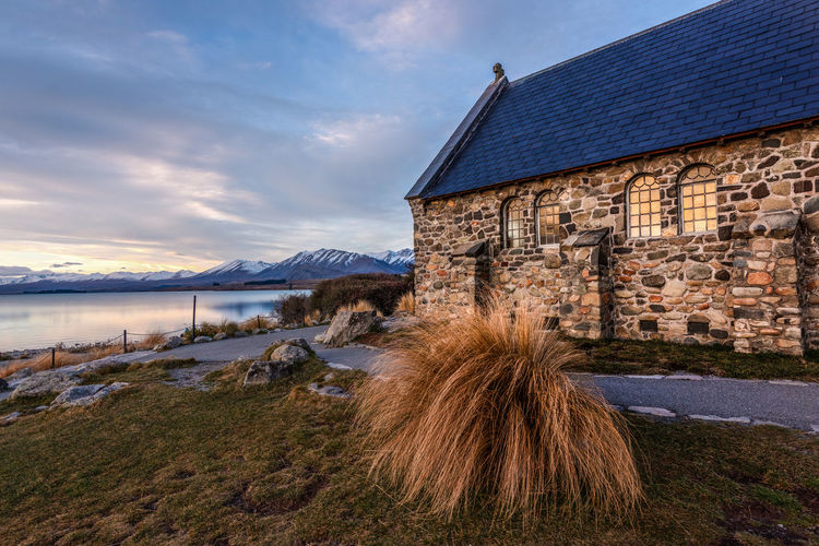 The Church at Lake Tekapo Architecture Beauty In Nature Building Building Exterior Built Structure Cloud - Sky Grass Lake Land Mountain Mountain Range Nature No People Outdoors Scenics - Nature Sky Water