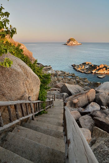 View of Shark Island. Koh Tao. Chumphon archipelago. Thailand Shark Island Koh Tao Koh Tao,Tao Island,Southern Thailand Surat Thani Province Chumphon Archipelago Thailand Thai Amazing Thailand Southeast Asia Southeastasia Asian  Sea Water Horizon Over Water Horizon Scenics - Nature Rock Beauty In Nature Island Tropical Staircase Stairs Stairway Rock - Object Tranquility Tranquil Scene Nature No People The Way Forward Beach Architecture