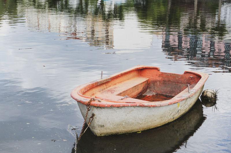 High angle view of abandoned boat moored at lake