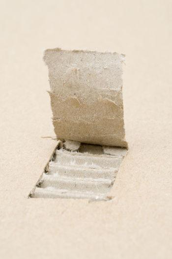 Close-up of peeled off cardboard box
