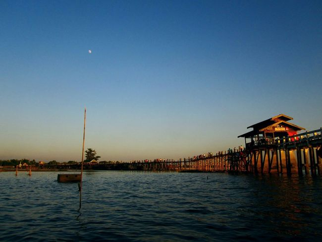 Lovely moon at U Bein Bridge The _ Mazzalong Boats⛵️ Relaxing Hello World Enjoying Life Asian Culture Myanmar View Ubeinbridge Mandalay Sunset Themoon Sky Taking Photos Myanmar Myway Asian