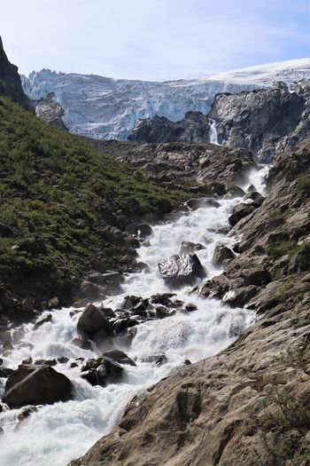 Beauty In Nature Rock Water Scenics - Nature Motion Nature Land Mountain No People Sky Environment Day Outdoors Rock Formation Non-urban Scene Flowing Water Power In Nature Flowing Norway Glacier Melting River Ice Travel Holidays