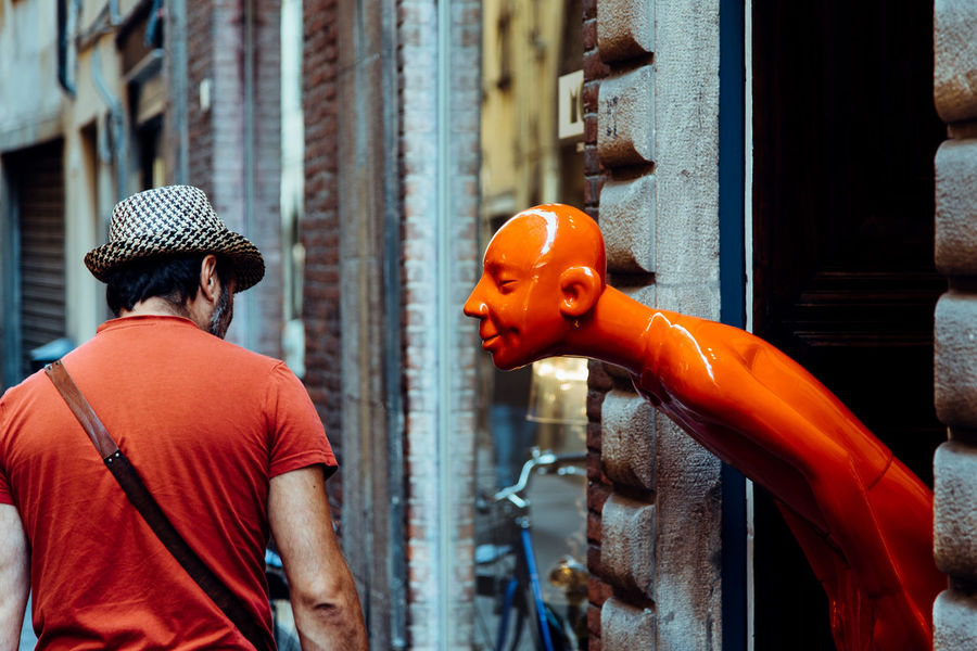 Fun Funny Life Random Architecture Art Arts Culture And Entertainment Building Exterior Built Structure Chance City Close-up Day Men Orange Color Outdoors People Real People Sculpture Statue Street Street Photography Streetphotography Surprise