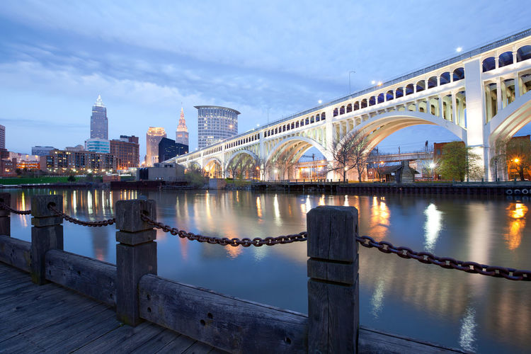Skyline of downtown Cleveland and Detroit Superios Bridge, Ohio, USA Cleveland Cuyahoga River Detroit Superior Bridge Architecture Bridge - Man Made Structure Building Exterior Built Structure City Cityscape Cloud - Sky Connection Day Night Outdoors Reflection River Sky Skyscraper Travel Destinations Urban Skyline Water