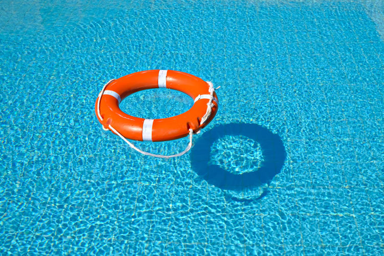 High angle view of life belt floating on swimming pool
