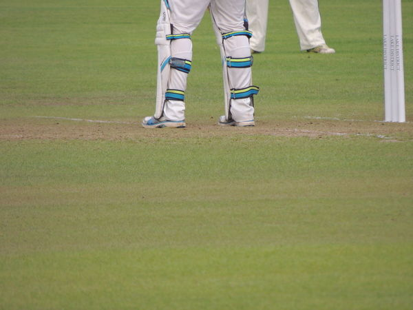 Cricket Field Adult Adults Only Competition Cricket Cricket Match Cricket! Cricketer Day Golf Grass Green - Golf Course Human Body Part Human Leg Leisure Activity Low Section Men One Man Only One Person Only Men Outdoors Sport Sportsman Standing Taking A Shot - Sport