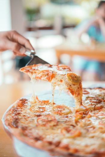 Margherita Food Pizza Human Hand Human Body Part Food And Drink One Person Real People Preparation  Indoors  Holding Food Table Freshness Lifestyles SLICE