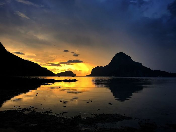 """There's nothing like returning to a place that remains unchanged to find the ways in which you yourself have altered."" N. Mandela Scenics Beauty In Nature Sunset Tranquility Nature Tranquil Scene Sky Reflection Water Mountain Sea No People Cloud - Sky Outdoors Silhouette Day Eyeem Philippines EyeEm Best Shots EyeEm Nature Lover EyeEm Masterclass Sunset_collection Travel Destinations El Nido EyeEm Gallery Eye4photography"