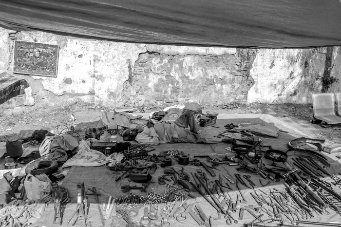 No customer time Afternoon Black And White Day Dirty India Iron Items For Sale Market Market Stall Messy Nap Old Old Products Products Resting Showcase April Sleeping Street Photography The Great Outdoors - 2016 EyeEm Awards Under Shadows Vendor