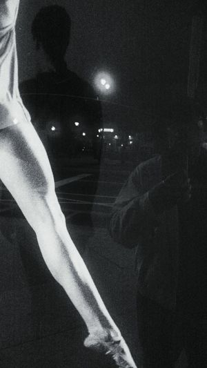 Close-up of hand holding hands at night