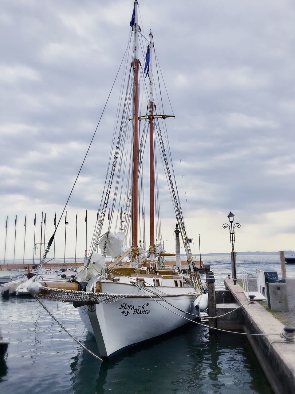 nautical vessel, transportation, mode of transport, moored, cloud - sky, sky, boat, mast, water, no people, outdoors, harbor, sea, day, nature, sailboat, tall ship, sailing ship