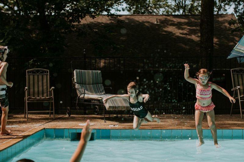 People enjoying in swimming pool