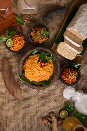 Sambal / Hot Sauce made from a mixture of variety of chili peppers Chili  Chili Pepper Delicious Freshness Garlic Ginger High Angle View Hot Indonesian Pepper Red Onion Salt Sambal Sauce Tempe Traditional