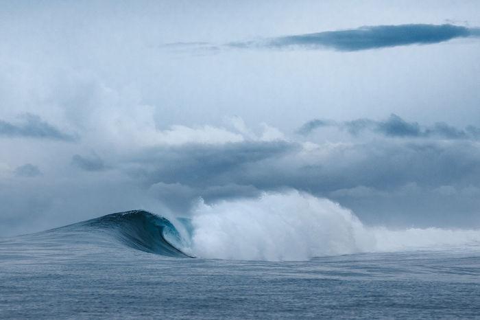 Wave in sea against sky