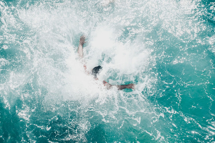 Directly above shot of man swimming into sea