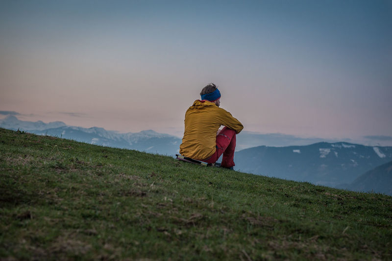 Enjoying the last light of the day in the mountains. Rear View Real People Sky One Person Beauty In Nature Scenics - Nature Leisure Activity Mountain Lifestyles Men Environment Landscape Tranquility Non-urban Scene Tranquil Scene Nature Grass Land Idyllic Looking At View Sunset