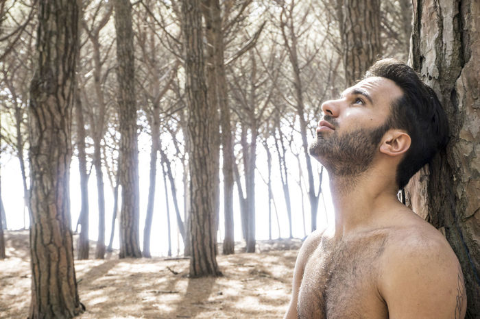 Adult Adults Only Beard Day Lifestyles Men Nature One Man Only One Person Only Men Outdoors People Real People Shirtless Tree Tree Trunk Wellbeing Young Adult