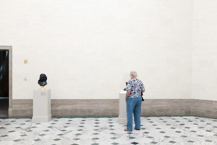 Rear view of woman in art museum