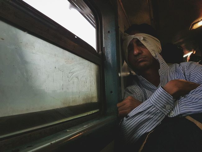 Spotted this guy in the train while travelling to Mumbai. Window One Person Men Subway Train Public Transportation Close-up People S7edgephotography Samsung Galaxy S7 Edge Daily Life Dailylifeindia Daily Routine The Street Photographer - 2017 EyeEm Awards
