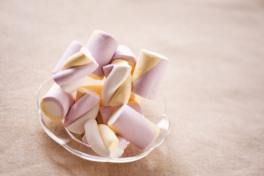 Puffy marshmallows twists on plate, sugar candy sweet product in white, yellow and pink color lying on transparent plate on tablecloth, cylindrical and twisted pieces in horizontal orientation, nobody. Candy Close-up Cylindrical Food Heap Marshmallow Marshmallows Marshmallowstime Minimalism No People Pile Pink Plate Portion Puffy Snack Snacks Sweet Sweet Food Sweets Tablecloth Twisted Twists Millennial Pink