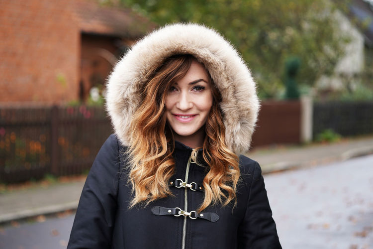 Autumn City Fashion Coat Day Fake Fur Fur Happiness Hood Hooded Jacket Lifestyles Looking At Camera One Person Outdoors Portrait Real People Smiling Street Street Style Urban Warm Clothing Winter Jacket Young Adult Young Woman