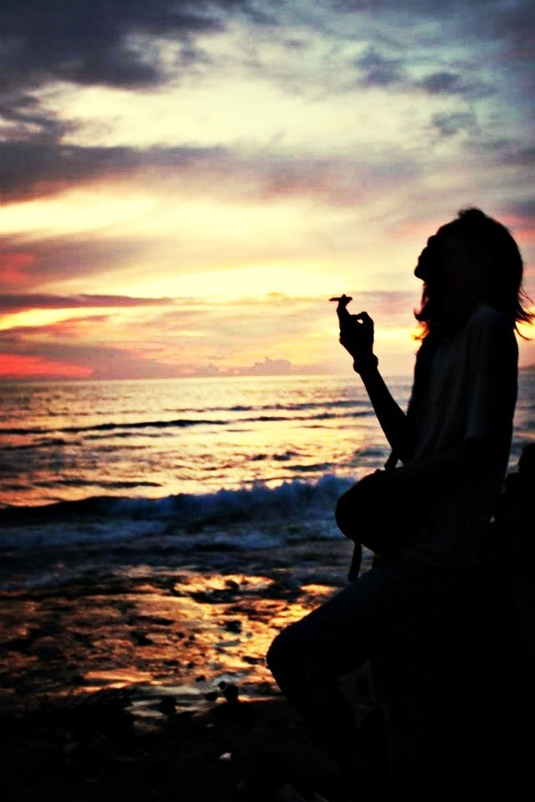 silhouette, sunset, sky, lifestyles, leisure activity, water, standing, sea, rear view, cloud - sky, scenics, person, beauty in nature, beach, men, horizon over water, nature, tranquility