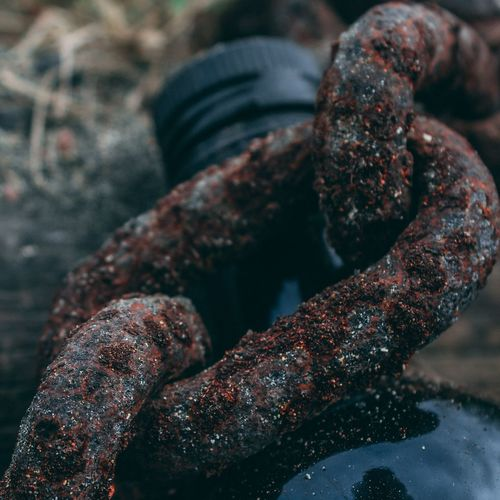 Chained! Rusty Bottle Abstract Wood - Material Wood Glass Glass - Material Chain Outdoors Close-up No People Day Focus On Foreground Nature First Eyeem Photo
