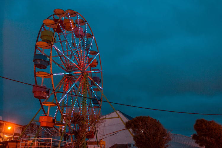 Sky Low Angle View Built Structure Amusement Park Ferris Wheel Nature Blue Amusement Park Ride Architecture Cloud - Sky Arts Culture And Entertainment Outdoors Dusk No People Illuminated Day Red Metal Lighting Equipment