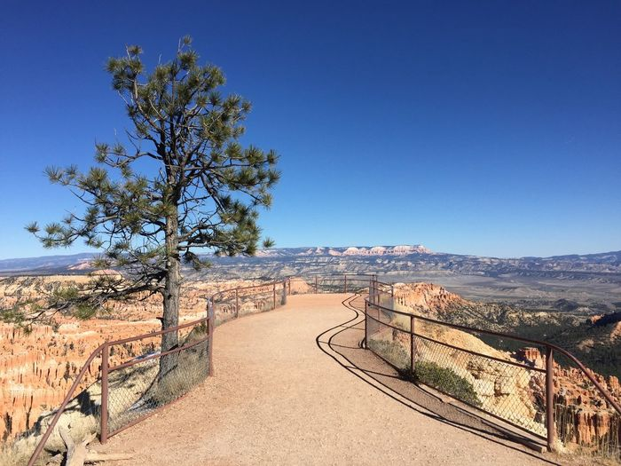 Footpath at bryce canyon national park against sky