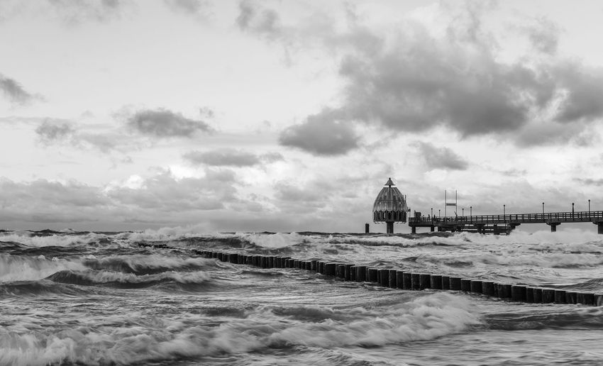 Calm after the Storm Ostsee Storm Zingst EyeEm Selects EyeEm Best Shots Hello World First Eyeem Photo Blackandwhite Baltic Sea Monochrome Fine Art Photography Sky Cloud - Sky Beach Land Nature Architecture Water Outdoors Built Structure Day Sea No People Scenics - Nature Beauty In Nature Sand Arts Culture And Entertainment Tranquil Scene