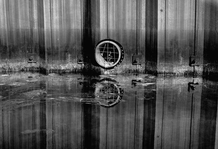 Not sure what kind, but a tube. A mini serie photo 2 out of 5. - black and white version. Photo 2 Out Of 5 Miniseries Black And White Version Black And White Black And White Photography Tube Habour Reflection Water Reflection Water Reflections In The Middle Full Frame Pattern Close-up Corrugated Iron Geometric Shape Standing Water Water Backgrounds Full Frame Close-up