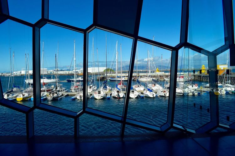 Harpa Architecture Blue Boat Building Exterior Built Structure City Cityscape Clear Sky Commercial Dock Day Harbor Marina Mast Mode Of Transport Nature Nautical Vessel No People Outdoors Sailboat Sea Sky Transportation Water Yacht
