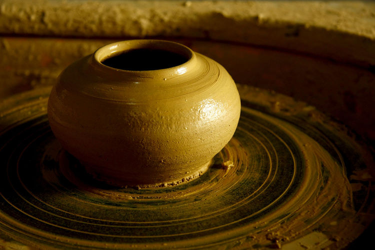 Close-up of pottery on wheel