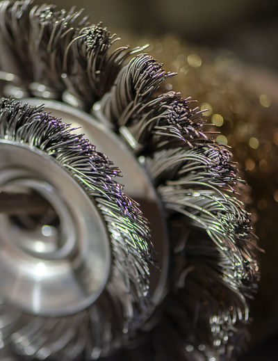 Close-up of a blacksmith work equipment wire brush