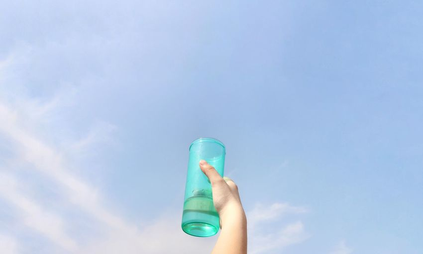 Human Body Part Human Hand Sky Blue Outdoors Summer Happiness Amazing View From My Point Of View Beauty Capture The Moment Enjoyment Bright Colors Beautiful View Fun Bottle Of Water Baoding