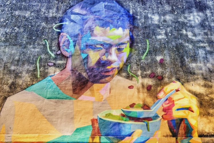 Expressionism style mural of Chinese guy with bowl of noodles, very colourful. Multi Colored One Person Portrait Human Face Mural Of Chinese Man With Bowl Of Noodles Outdoors Day ASIA Nawfal Johnson Mural Urban Artwork Urban Mural Art Penang Malaysia