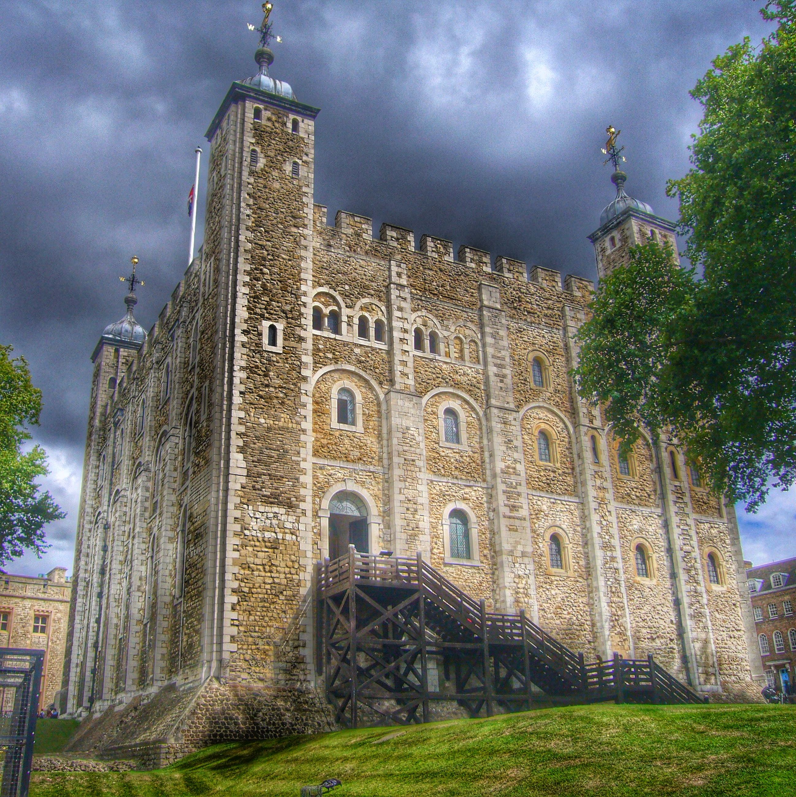 architecture, built structure, building exterior, sky, low angle view, cloud - sky, cloudy, tree, history, old, place of worship, religion, cloud, church, tower, spirituality, outdoors, famous place, travel destinations