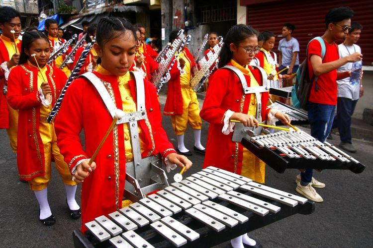 members of a marching band play music during a parade ASIA Asian  Philippines Filipino Human People person Musician Music Musical Instrument Musical Equipment Lyre Xylophone Marching Band March Marching Festival Fiesta Antipolo, Rizal Ph Sumakah Festival Celebration Musician Musical Instrument Music Arts Culture And Entertainment Percussion Instrument Festival Carnival