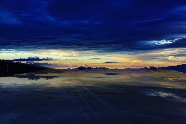 Cloud - Sky Sky Tranquil Scene Sunset Beauty In Nature Tranquility Scenics - Nature Landscape Environment Non-urban Scene Nature Water Blue No People Land Orange Color Idyllic Outdoors Dramatic Sky