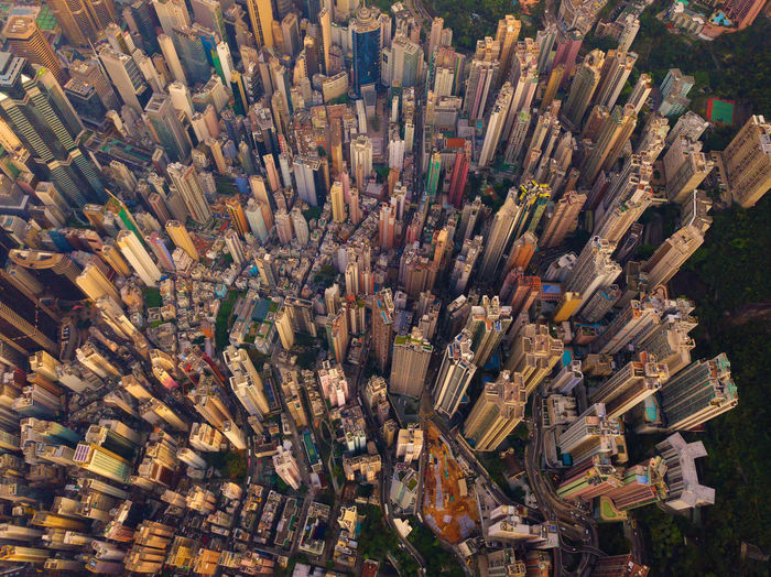 Aerial view of Hong Kong Downtown, China. Financial district and business centers in smart city in Asia. Top view of skyscraper and high-rise buildings at sunset. Top view Network Connection City Cityscape Hong Kong Downtown China Financial District  Skyscrapers Buildings Architecture Business Aerial View Drone  Top View ASIA Victoria High Angle View Backgrounds Full Frame Crowd Abundance Crowded Day Building Exterior Outdoors Large Group Of Objects Skyscraper Building Travel Destinations Office Building Exterior Built Structure