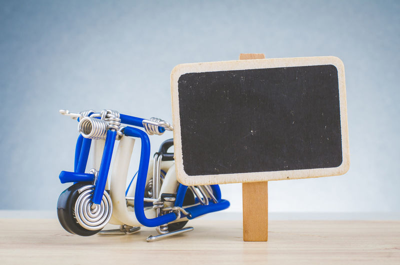 travel concept, miniature handcrafted scooter on wooden desk shot over lighting effect Transportation Signage Photography Studio Shot Studio Photography Wooden Concept Art Art And Craft Art is Everywhere Lighting Effects Lighting Template Backgrounds Object Objects Of Interest Interesting Hobby Picture Desk Design Elementary Age Close-up Macro Miniature