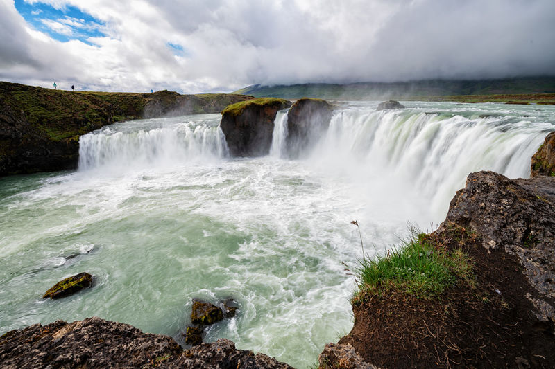Godafoss is a waterfall in Iceland. Goðafoss Goðafoss Waterfall Terquoise Beauty In Nature Cloud - Sky Environment Flowing Flowing Water Godafoss Landmark Long Exposure Motion Nature No People Outdoors Power In Nature Power Line  Rock Rock - Object Scenics - Nature Sky Solid Travel Destinations Water Waterfall